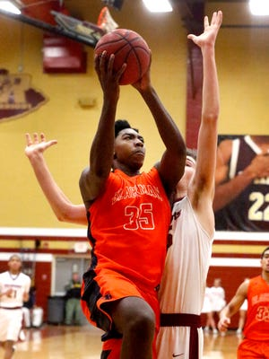 Blackman's Brandon Thomas (35) goes up for a shot as Riverdale's Brayden Siren (35) defends him on Friday, Feb. 2, 2018, at Riverdale.