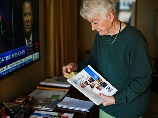 Blanche Williams, 82, of Riverview is 41-year retiree from who worked in purchasing at Ford Motor Company and is going over options for medicare coverage during open enrollment at her home on Thursday, Oct. 29, 2015.