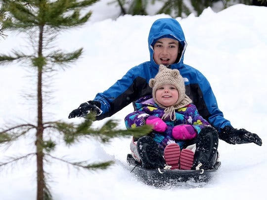 Jacob Foreman, 13, of Salem, sleds with his sister, Ellie May, 1, at the Maxwell Butte Sno-Park at Santiam Pass in Oregon on Sunday, Jan. 24, 2016. The snow depth is 48 inches in the pass for Sunday.