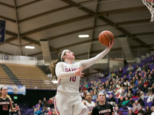 South Salem's Jordan Woodvine goes up for a basket in a game against Oregon City in the first round of the OSAA Class 6A state tournament on Wednesday, March 9, 2016, at the University of Portland. South Salem defeated Oregon City 46-30.