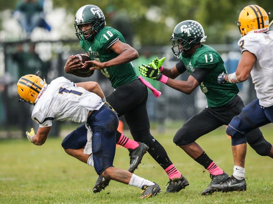 Cass Tech's (10) Aaron Jackson runs the ball during Cass Tech's 35-7 win over Dearborn Fordson Saturday in Detroit.