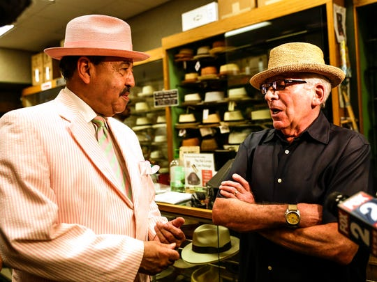 Judge Craig Strong left, a frequent customer, chats with Paul Wasserman, owner of Henry the Hatter at the store in downtown Detroit, Friday, June 30, 2017.