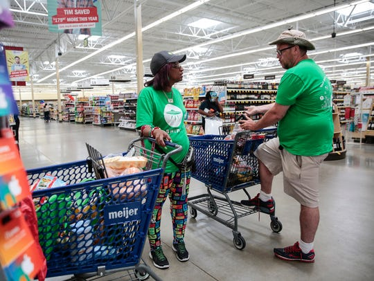 Shipt shopper Gina Moorman of Detroit chats with a