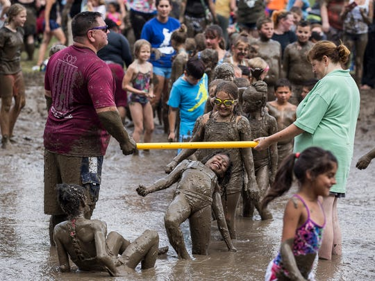 Hundreds of children from Metro Detroit attend the annual Mud Day at Nankin Mills Recreation Area, Tuesday, July 11, 2017 in Westland.
