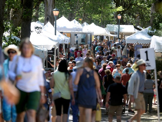 The Salem Art Fair & Festival at Bush's Pasture Park in 2017. A proposal before the Salem City Council would allow hard-liquor sales at events in two city parks.