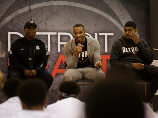 The Building Bridges through Basketball program tips off with Detroit Police Sgt. Kirk Kelsey, Pistons Avery Bradley, Tobias Harris and Stanley Johnson (not seen) at  S.A.Y. Detroit Play Center in Detroit Mich., Wednesday, October 11, 2017.