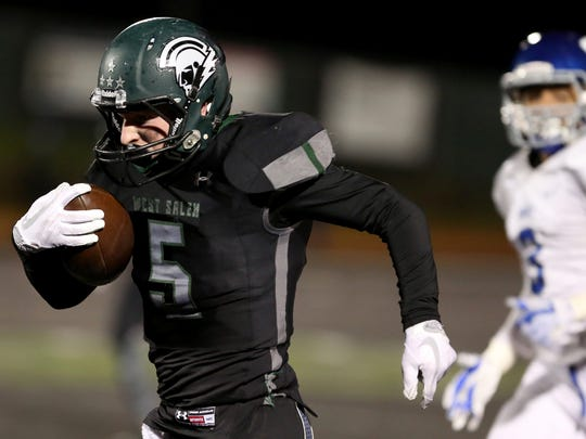 West Salem's Jacob Denning (5) rushes in the Grant vs. West Salem football game in the second round of the OSAA Class 6A playoffs at West Salem High School on Friday, Nov. 10, 2017. West Salem won the game 33-24.