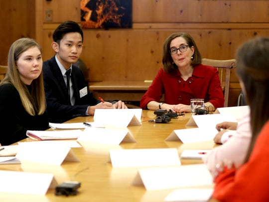 Gov. Kate Brown meets with high school and college students about guns and school safety at the Oregon State Capitol in Salem on Monday, March 5, 2018.