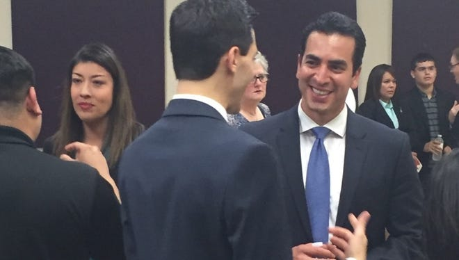 Democratic congressional candidates Ruben Kihuen, left, and Lucy Flores, right, visit with prospective voters Thursday night in North Las Vegas.