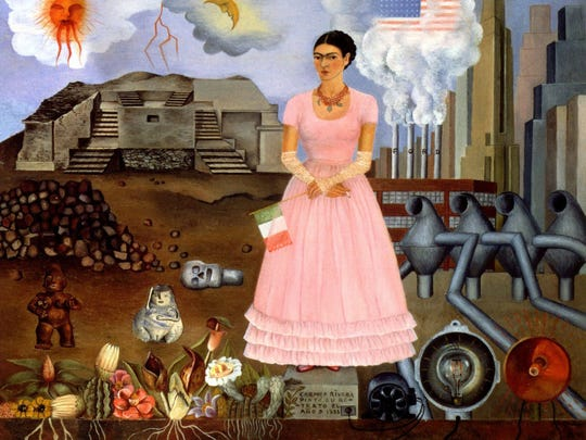 """Frida Kahlo's """"Self-Portrait on the Borderline between Mexico and the United States,"""" done in oil on metal in 1932."""