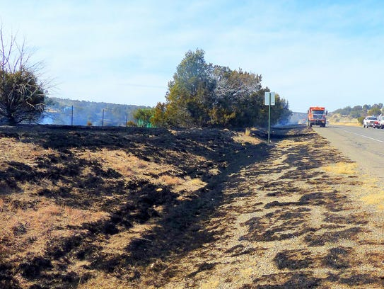 Burned grass shows the path of the fire.