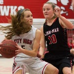 Iowa City Highs's Sydney Schroder drives against Linn-Mar's Ally Johnson during the first half at Iowa City High School in Iowa City. Friday, February 5, 2016.