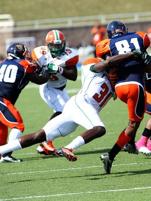 FAMU's safety Neal Cunningham takes down receiver Antonio Jefferson in last year's game against the Bears.