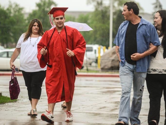 Rocori graduate Keenan Corona isn't fazed by the downpour on Saturday night.
