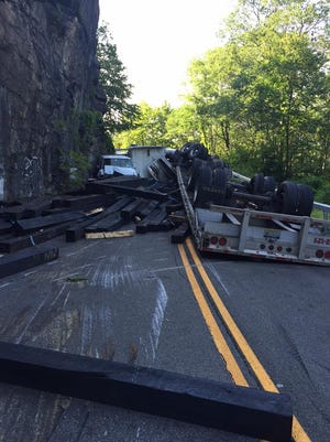 An overturned flatbed trailer spilled its load on Bear Mountain Bridge Road, Route 6, in Cortlandt on Monday, July 27, 205.