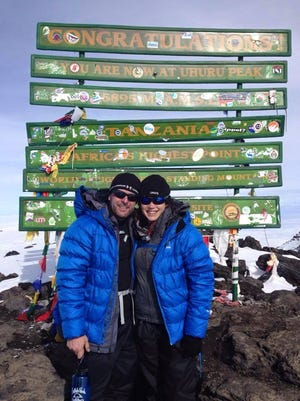 Jeremy and Claire Jungling stand on the summit of Mount Kilimanjaro in 2014. The couple is running in the IMT Des Moines marathon.