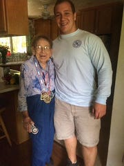 Gabe Beyer poses for a photo with Mrs. Katie Solluhub,