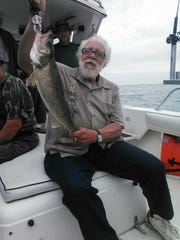 Leroy Oliver poses with a large walleye caught during