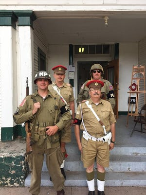 Dress for their parts in the March on Rome World War II reenactment, participants last year stand in front of the buildings at historic Fort Stanton.