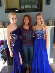 Cathy Hocking, center, poses with her daughters Kelsey,