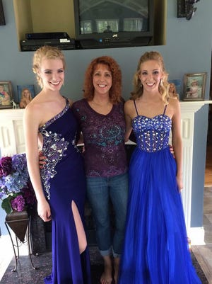 Cathy Hocking, center, poses with her daughters Kelsey, left, and Karli Richardson.