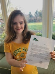 AnnCatherine Heigl smiles with her official acceptance