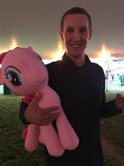 Justin is very proud of the prize he won. All of the 5-year-olds at the fair are incredibly jealous.