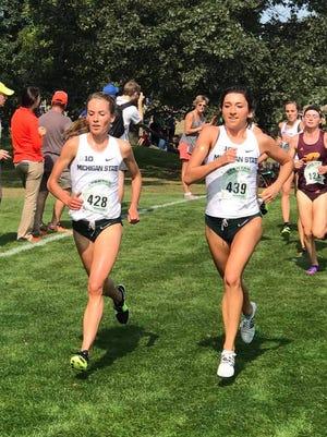 Michigan State University freshman Maggie Farrell (left) and senior Erin McDonald compete at the MSU Spartan Invite on Sept. 15, 2017.
