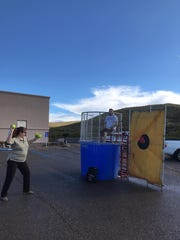 Otero County Undersheriff Lily Schnell attempts to dunk a colleague in a dunking booth Sept. 30 during the Christ Community Church car show fundraiser for Kids Inc. Child Advocacy Center.