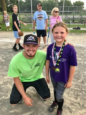 Zac Sheaffer, the program director for Hanover Borough's new baseball and softball program, is excited to rebuild the sport in his hometown. In this photo, he poses with Lilli Wagaman after the final game for morning softball program during the summer of 2017.