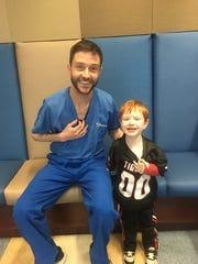 Nurse Shawn Fontenot and Joseph Ryan show off their