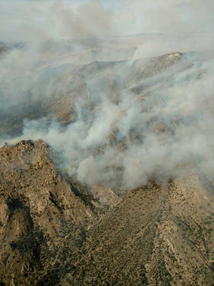 The fire had engulfed about 2,000 acres of land in Cochise County as of 7 p.m. Saturday.