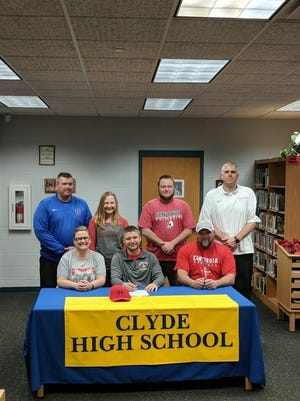 Clyde's Conner Long continues his football career at Concordia. He's joined at his announcement by Clyde athletic director and assistant coach Ryan Greenslade, Kennedi Long, Kade Long, Fliers coach Ryan Carter, Jen Long and Ray Long.