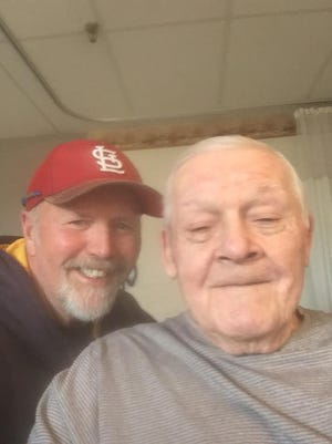 Local umpires Larry Lewis (left) and Ed Landes share a moment during Landes' stay in a local nursing home. Landes passed away last Monday at age 83.
