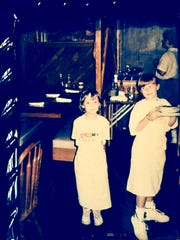 In 1987, Stefanie, right, 9, and her sister, Katie, 7, help bus tables and mom and dad's restaurant, McCabe Pub