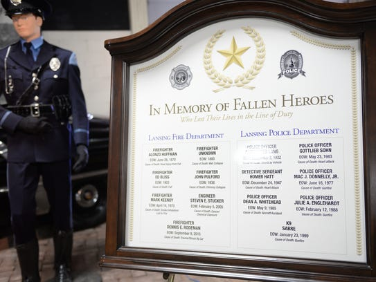 The names of firefighters and police officers who have