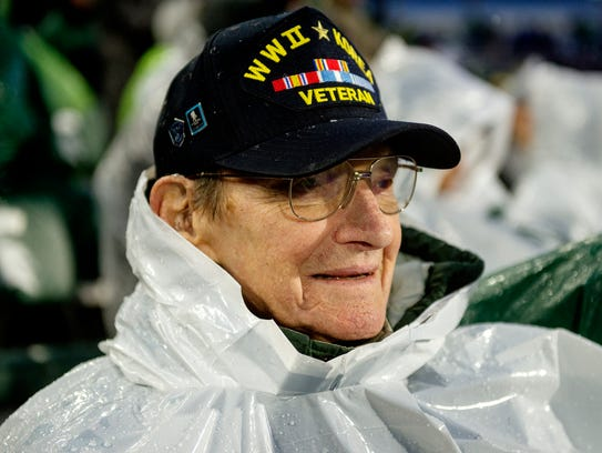 Howard Grider, 92, of Okemos, watches the Spartans take on Maryland during the second quarter on Saturday, November 18, 2017, at Spartan Stadium in East Lansing. Grinder has been a season ticket holder for 53 years.