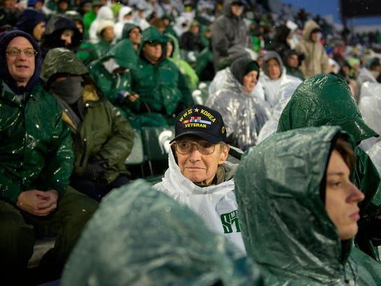 Howard Grinder, 92, of Okemos, watches the Spartans take on Maryland during the second quarter on Saturday, November 18, 2017, at Spartan Stadium in East Lansing. Grinder has been a season ticket holder for 53 years.