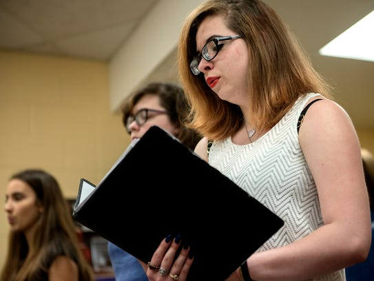 Senior Calista Cremeans sings with her classmates during