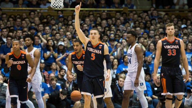 Virginia's Kyle Guy celebrates after his team defeated Duke at Cameron Indoor Stadium.