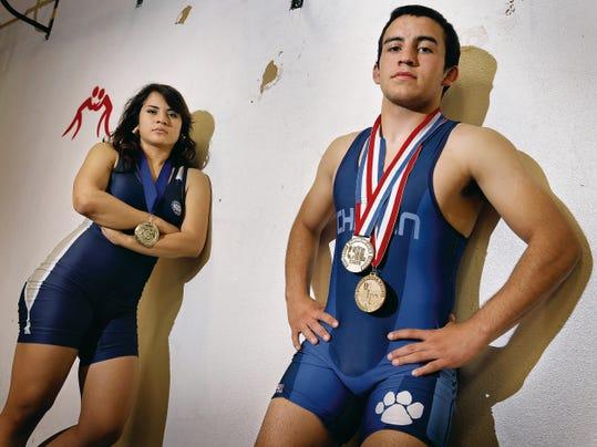 MARK LAMBIE—EL PASO TIMES  All-City wrestlers are Europa Cabada of Coronado and Andres O'Brien of Chapin.