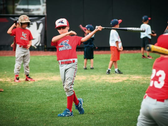 Jett Loe/Sun-News   Participants at the Brian Green Youth Summer Baseball Camp practice their swings on Tuesday at Presley Askew Field on the New Mexico State University campus.