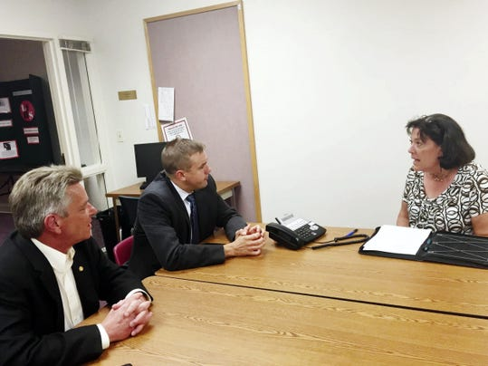Kim Kreider-Umble, director of Lebanon Family Health Services, discusses the impact the state budget impasse is having on the agency with Pennsylvania House Majority Whip Bryan Cutler, center, and Rep. Russ Diamond during their visit to the LFHS office in Lebanon Monday.