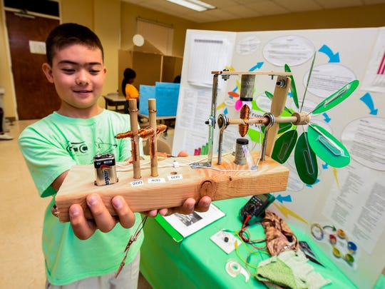 In this May 5, 2018, file photop, home-schooled student Kazu Friebert displays a model of a wind turbine at the 40th Annual Island Wide Science Fair at the University of Guam in Mangilao.