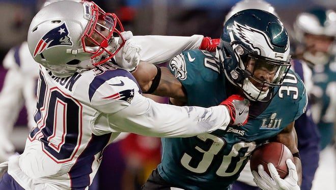 Philadelphia Eagles running back Corey Clement (30), right, runs against New England Patriots strong safety Duron Harmon (30), during the first half of the NFL Super Bowl 52 football game, Sunday, Feb. 4, 2018, in Minneapolis.