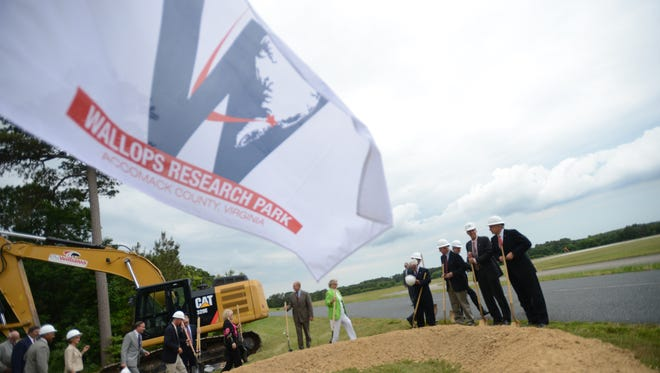 FILE IMAGE: Officials including Virginia Governor Terry McAuliffe, far right, gather to break ground on the planned Wallops Research Park on June 9, 2014.