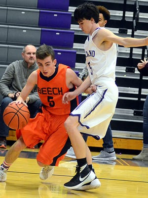 Beech High sophomore Jake Butler dribbles along the baseline as Portland sophomore Bryce Keith defends during fourth-quarter action.