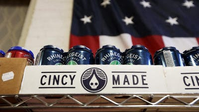 Rhinegeist Beer on the shelves in the office space of HalfCut, Pedal Wagon and Gomez Salsa in Over-the-Rhine.