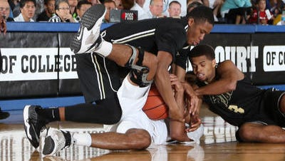 Basil Smotherman (left) and P.J. Thompson battle for a loose ball against Missouri at the EA Sports Maui Invitational earlier this season.