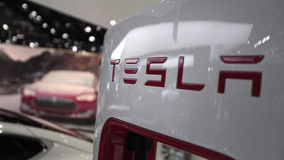 The Tesla Motors Inc. logo is seen on a charging station at the company's booth during the 2014 North American International Auto Show in Detroit, Michigan, U.S., on Tuesday, Jan. 14, 2014.